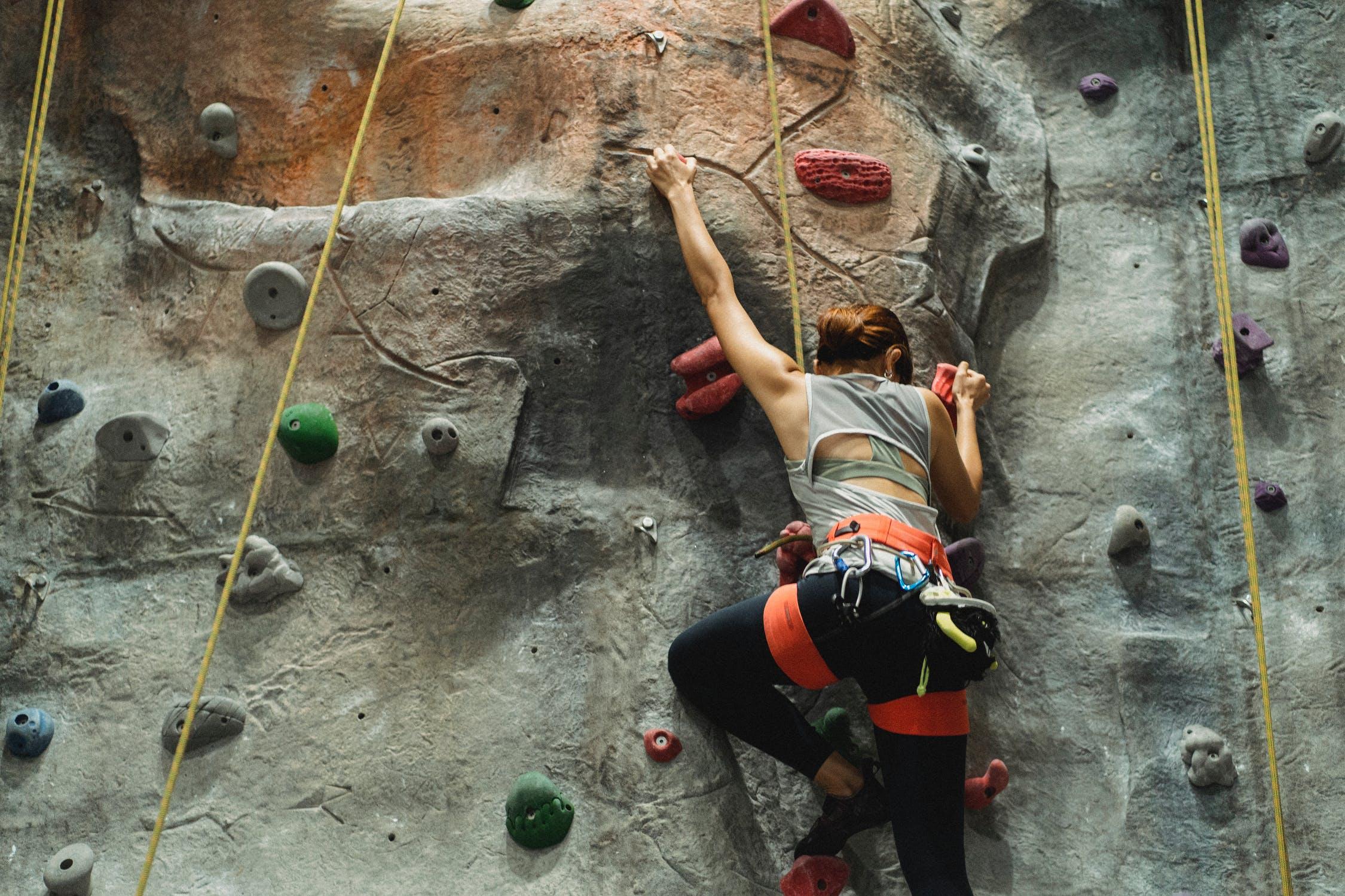 partaking in rock climbing activities hobby